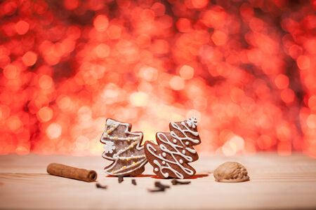 Christmas gingerbread with red blurred background looks like fireworks