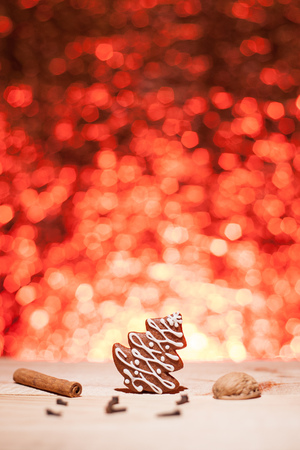 Christmas gingerbread with red blurred background looks like fireworks photo