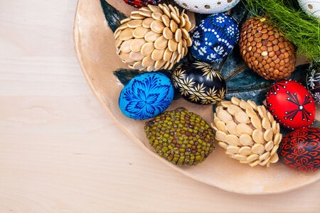 Top view of easter eggs in wooden bowl on wooden backgroud. Stock Photo - 22747429