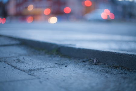 Blurred background - night street with street lights, great for design.