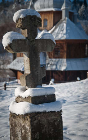 An orthodox cross near a church in Eastern Europe. A perfect winter day. Stock fotó