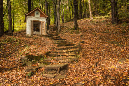 Catholic shrine in the autumn woods.