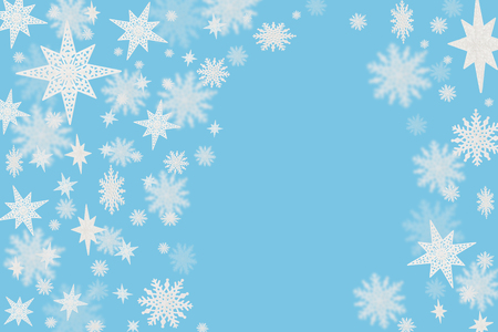 Christmas blue background with snow flakes and stars with blurred