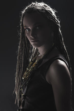 Portrait of young beautiful girl with stylish make-up and dreads