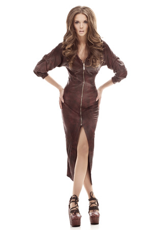 Beautiful tall girl in a tight brown leather dress