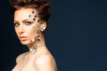 sumptuousness: portrait of beautiful girl with diamonds on her face