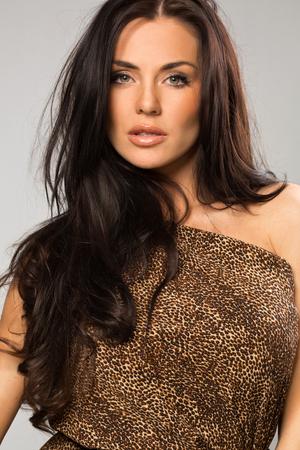 Sexy girl wearing leopard fur