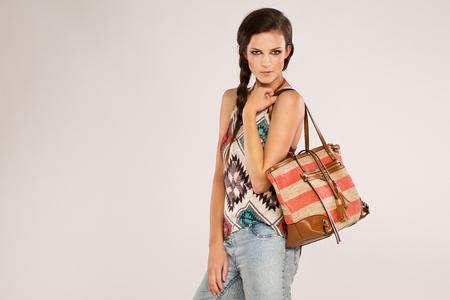 Teenage on gray background shopping Stock Photo