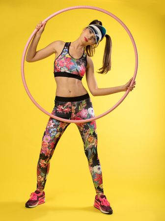 Sports women with pink hulahop