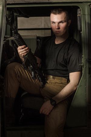 Men in black T-shirt holding gun
