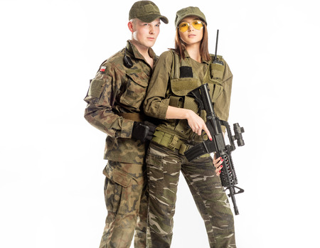 Man and woman in soldier's suit on white background.