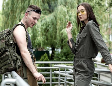 Sexy woman and man who smoking a cigarette.