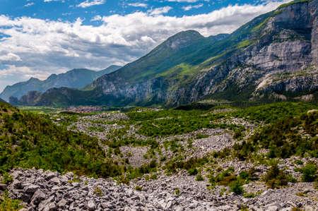 Mountain pass and city in Alps Фото со стока