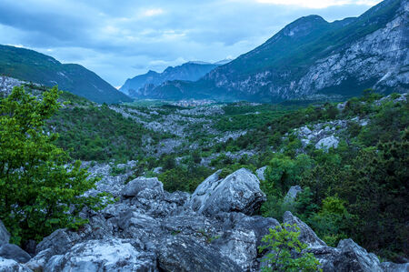 Mountain pass in Alps at dusk Фото со стока