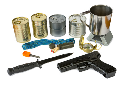 Survival kit with emergency supplies and gun photo