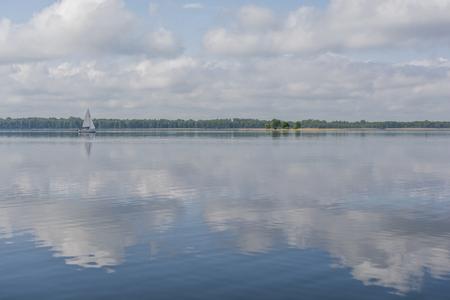 Sail boat on a lake Фото со стока