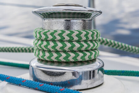 Sail yacht - close up on winch and green rope Фото со стока