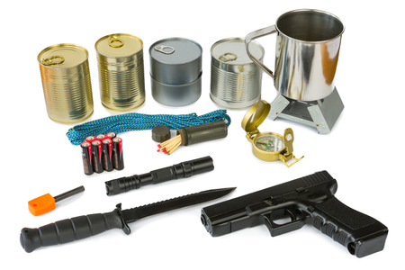 Survival kit with emergency supplies, flashlight and gun