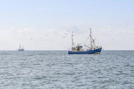 Fishing boats on a sea Фото со стока