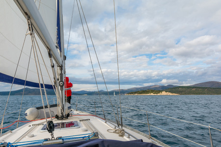 Sailor on a Bow of Sailing Yacht