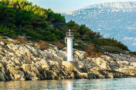 White navigation beacon on island Фото со стока