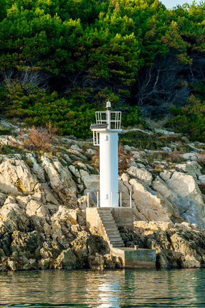 White navigation beacon on a coastline