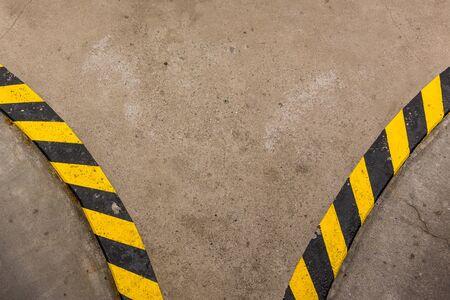 yellow black curbs at the corner of the road Фото со стока