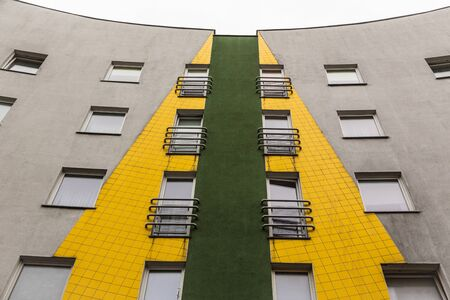 greenish yellow residential building with a profound perspective