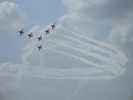 Britain group Red Arrows on military fighters Hawk T1 with smoke in sky  Russia, Zhukovsky, 12 August 2012
