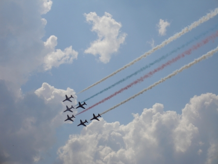 pilotage: Britain group Red Arrows on military fighters Hawk T1 with smoke in sky (Russia, Zhukovsky, 12 August 2012)
