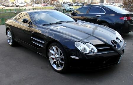benz: Luxury black Mercedes Benz McLaren SLR on street