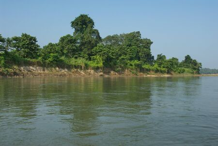 dugout: Banks of Rapti river as seen from a dugout Stock Photo