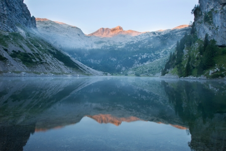 Krn lake and Mt  Krn at sunrise photo