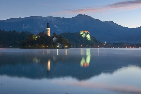 karavanke: Castle and island of Bled in dawn, just before the sunrise, with Karavanke mountains in the background