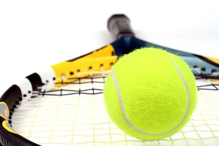 handled: Close up of a tennis ball and racket isolated
