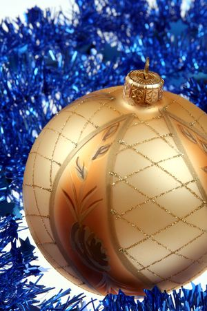Golden bauble and blue chain photo