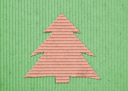 Recycled handmade Christmas-tree on green background Stock Photo - 3848667