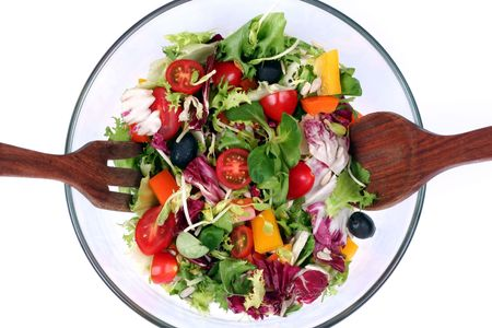 A half of fresh salad mix in round bowl, isolated, from above photo