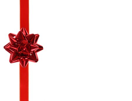 Red holiday ribbon bow on white background