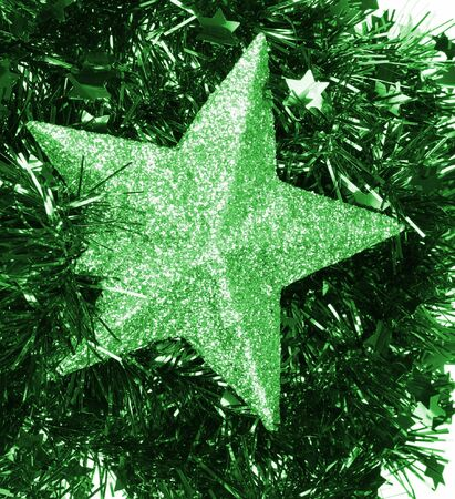flickering: Green flickering star laying on green christmas chain
