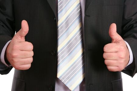 Double OK - thumb up gesture of businessman  hand Stock Photo - 3899132