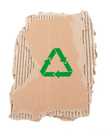 damaged cardboard with recycling symbol photo