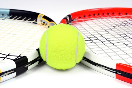 Two tennis rackets and ball, close-up, isolated