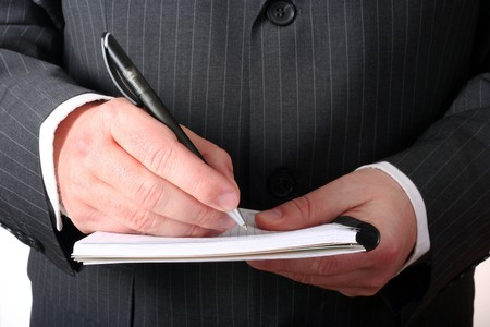 Businessman hand making notes isolated photo