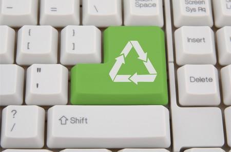 Computer keyboard - green  recycling key Stock Photo