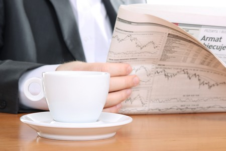 business news: businessman read business news and drinking coffee