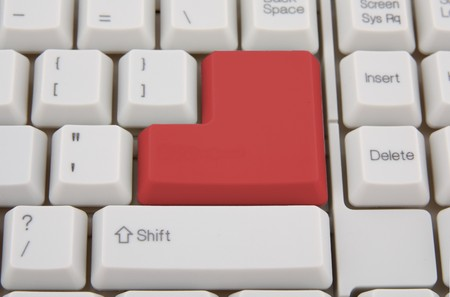 Computer keyboard with red Enter key, business concept photo