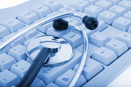 A stethoscope on a computer keyboard (on blue tone) Stock Photo - 4105900