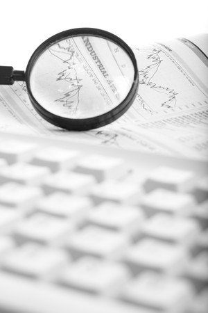 magnifying and economy newspaper and keyboard Stock Photo - 4105897