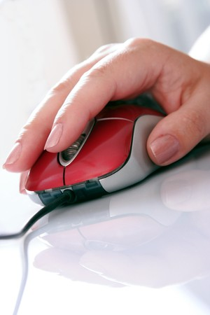 red omputer mouse and womens hand photo
